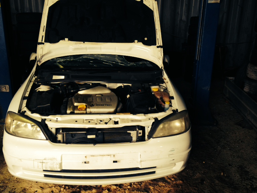 A DEOL Car Solutions wrecker is in the process of dismantling a written-off Mitsubishi car